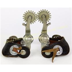 Crockett stamped single mounted spurs very good with 2 piece leather straps.  Est. 150-300