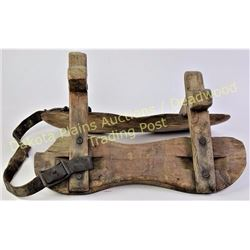 "Early wood pack saddle with partial rigging 20"" long.  Est. 50-125"