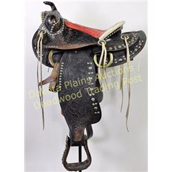 1950's Saddle King of Texas saddle, black spotted floral stamped, with strings, cantle and gullet bi