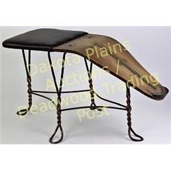 Early boot or shoe store foot stand with brass measurement strip and padded seat.  Est. 100-200