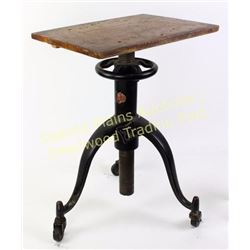Early draftsman table with deluxe adjustable cast iron base on wheels.  Est. 75-175