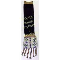 "Sioux beaded pipe bag 33"" long including tabs with blue trade cloth throad, C. 1900's.  Est. 650-120"