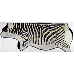 "Large Zebra hair on with felt backing 89"" long, shows some areas of loss.  Est. 25-100"
