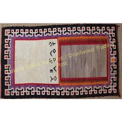 Vintage Navajo rug woven in center Casey Todac. Rug shows moderate use with some staining and small