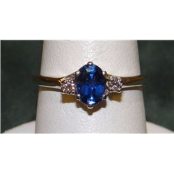 Yogo Sapphire ladies ring, 1.15 ct oval Yogo, 7.5 mm x 5 mm, with 2 x .05 rd diamonds, set in 14 kt