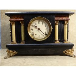 Black mantle clock, made USA, 4 columns