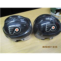 Two Miniture Autographed Black Flyers Helmets