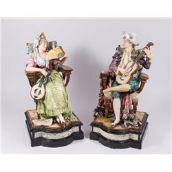 Pair of Majolica Seated Figures