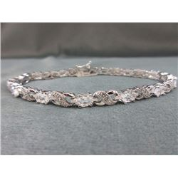 BRACELET - 12  OVAL FACETTED WHITE TOPAZ & DIAMONDS IN STERLING SILVER INFINITY LINK SETTING - ESTIM