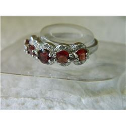 RING - 1.5CTW (5PC) ROUND FACETED GARNET  & 2 ROUND FACETED DIAMONDS IN STERLING SILVER SETTING - IN
