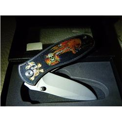 NEW FOLDING KNIFE WITH SKULL IMAGE