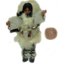 Eskimo Tourist Doll & Medallion