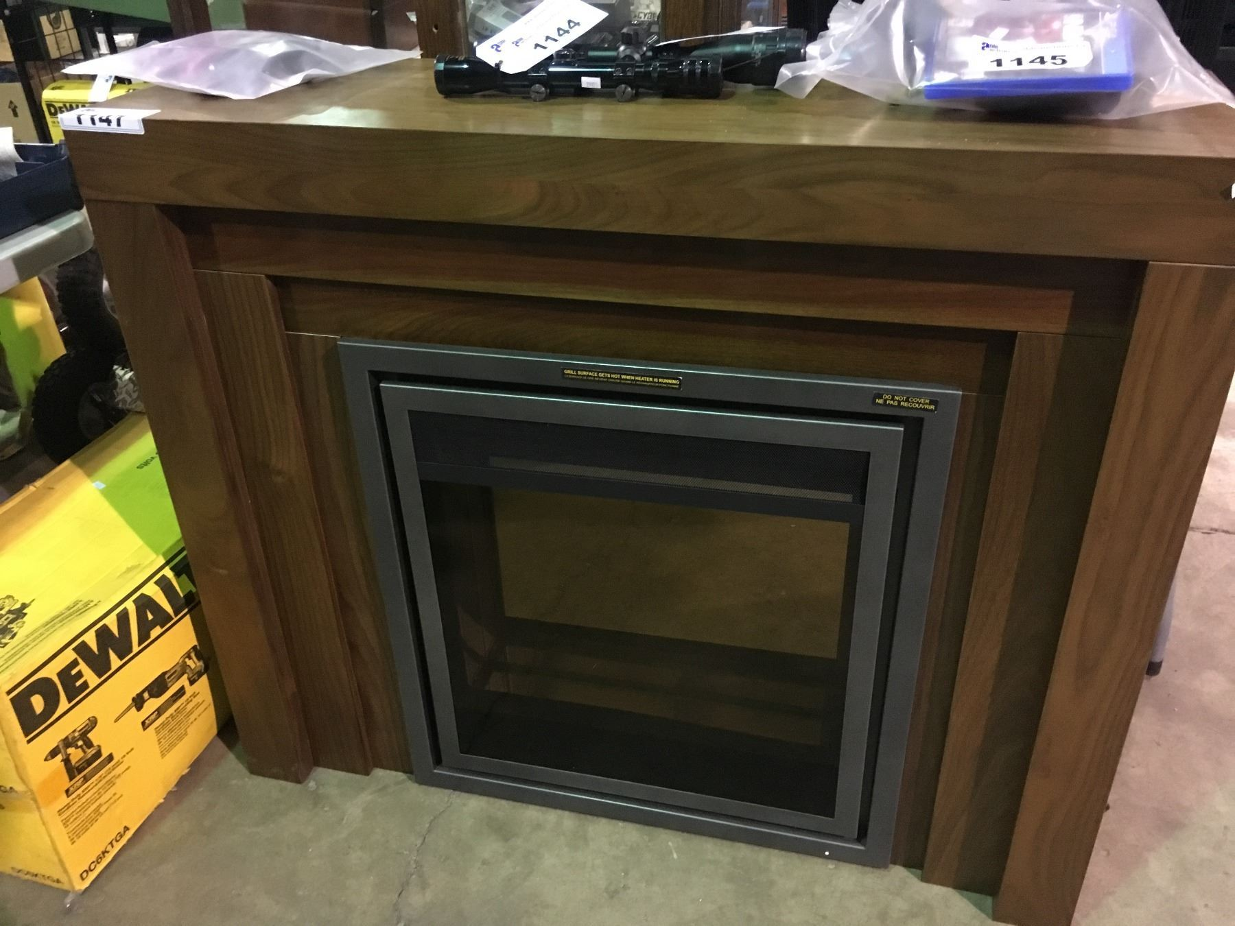 Glass Front Electric Fireplace With Dark Wood Mantle