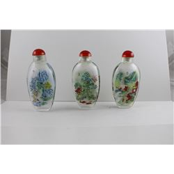 THREE HAND PAINTED GLASS SNUFF BOTTLES, WITH STOPPERS