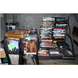 SHELF LOT OF DVDS AND CDS