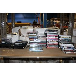 SHELF LOT OF CDS, DVDS AND DVD PLAYER