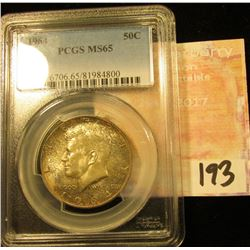 1964 P Kennedy Half Dollar. PCGS slabed MS 65. Obverse toned.