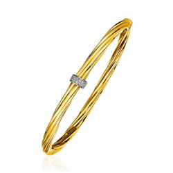 14K Yellow Gold and Diamond Twisted Bangle Bracelet (1/10 ct. tw.)
