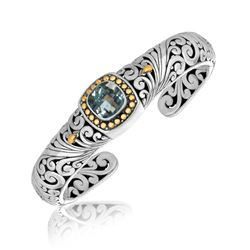 18K Yellow Gold and Sterling Silver Baroque Open Bangle with a Blue Topaz Stone