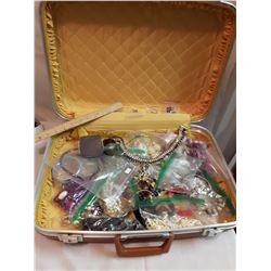 Orange Hard Backed Suitcase With Costume Jewellery