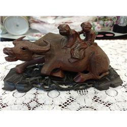 "WATER BUFFALO WITH CHILDREN, HANDCARVED HARD WOOD ON HAND CARVED STAND, 8"" LONG"