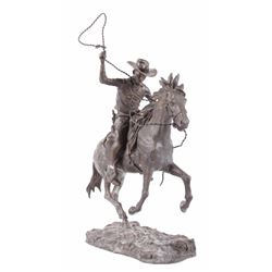 Cowboy on Galloping Horseback Sculpture