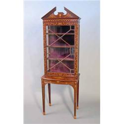 An Edwardian Inlaid Mahogany Display Cabinet With Broken Arch Pediment Over A Single Astragal Gl