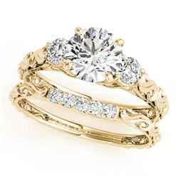 0.89 CTW Certified VS/SI Diamond 3 Stone 2Pc Wedding Set 14K Yellow Gold - REF-119T8X - 32050
