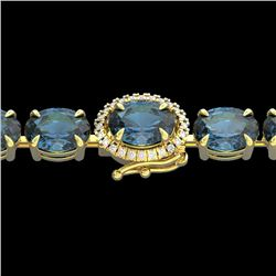 19.25 CTW London Blue Topaz & VS/SI Diamond Tennis Micro Halo Bracelet 14K Yellow Gold - REF-116T4X