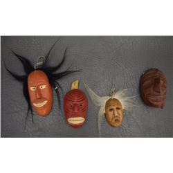 FOUR IROQUOIS WOODEN MASKS