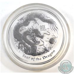 2012 Australia $10 Year of the Dragon 10oz Fine Silver Coin (TAX Exempt). Lightly toned.