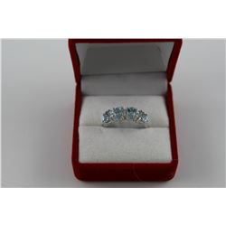 BLUE TOPAZ & DIAMOND JOURNEY SET RING.  4 OVAL TOPAZ , 2 DIAMONDS.  STERLING SILVER