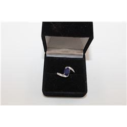 BLUE IOLITE WAVE DESIGN RING.  OVAL CUT. RICH DEEP BLUE.  STERLING SILVER