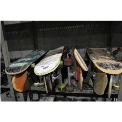 SHELF LOT OF SKATEBOARDS