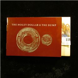 THE HOLEY DOLLAR & THE DUMP.  THIS IS A 2 COIN SET.  THE HOLEY DOLLAR CONTAINS 1 OUNCE OF SILVER.  T