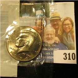 1999 P Kennedy Half Dollar in Littleton Coin Co. packaging. Gem BU.