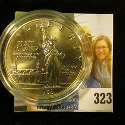 1986 P U.S. Statue of Liberty Gem BU Silver Dollar encapsulated in a cracked holder.