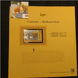 1998 Colorado Waterfowl $5.00 Stamp depicting a flock of Rehead Ducks, Mint, unsigned, in vinyl page