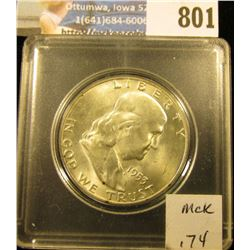 1953 D Franklin Half Dollar, Brilliant Uncirculated. Speckled black toning on reverse. Mounted in a