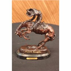 Signed Frederic Remington Cowboy on horse batteling a Rattle Snake Bronze Statue
