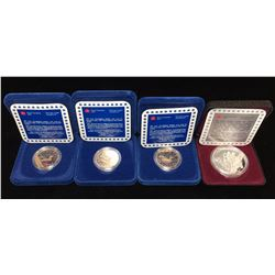 Lot of 4 - 1990 Proof Silver Dollar and Three 1987 $1 Special Edition Proof Loon
