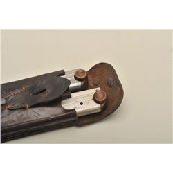 Lot of 2 wood based Luger magazines in a  double leather magazine pouch.     Est.:   $75-$150.