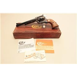 Colt New Frontier revolver, .45 caliber,  Serial #08220NF.  The pistol is as new in the  original fa