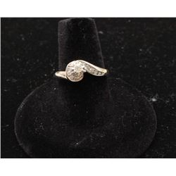 14k white gold ring set with a center diamond weighing