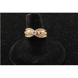 Uniquely designed ring in 14 k yellow gold set with
