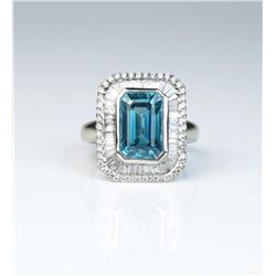 Exquisite ring featuring a Fine Blue Zircon weighing approx 5.74