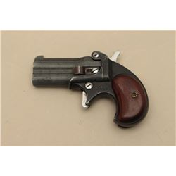 German-made O/U derringer by Hawes.22 Magnum caliber, 2.5 barrels, wood
