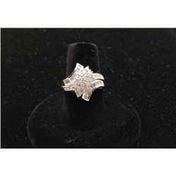 One ladies diamond cluster ring set with round and baguettes