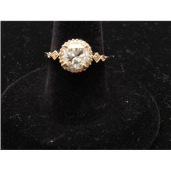 One 14k yellow gold halo ring set with a 1.55ct