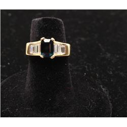 One ladies ring in 14k yellow gold set with an